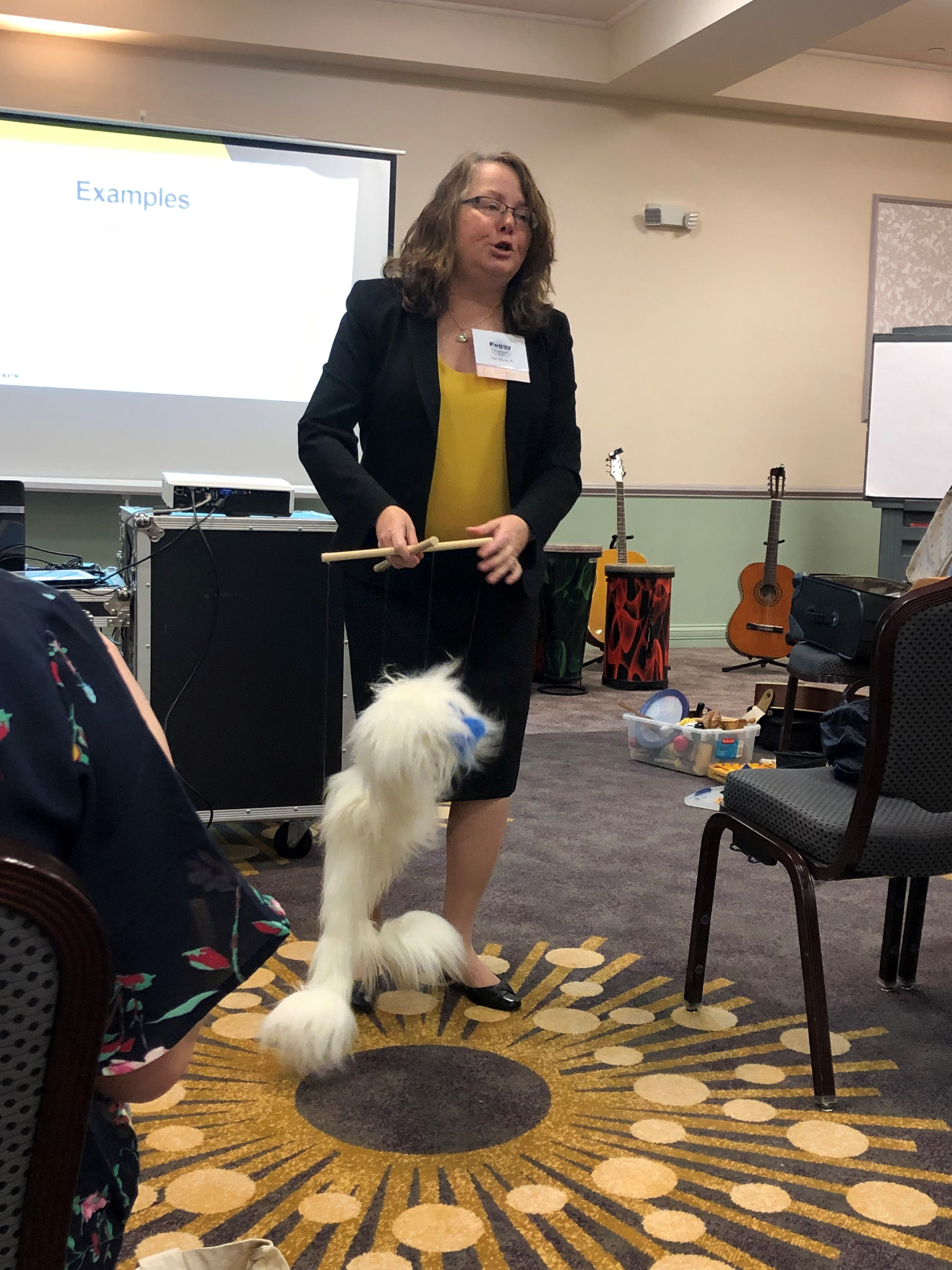 Music therapist and educator Peggy Farlow demonstrates an activity with a marionette during a music therapy conference
